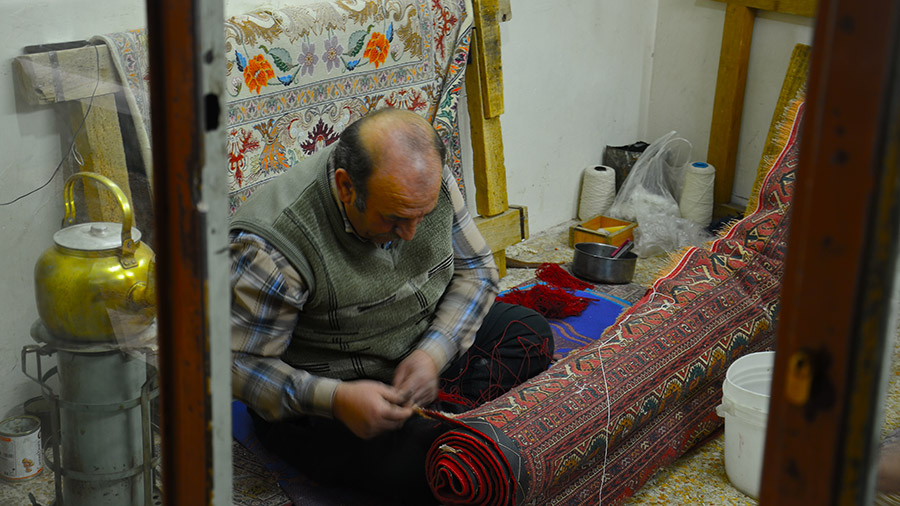 Carpet repairing shop in Isfahan bazaar