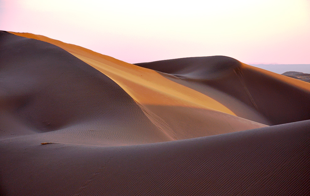 Desert resembling the shape of sleeping lady with dunes