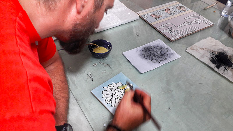 experiencing tile design in a workshop in Qom city, Iran